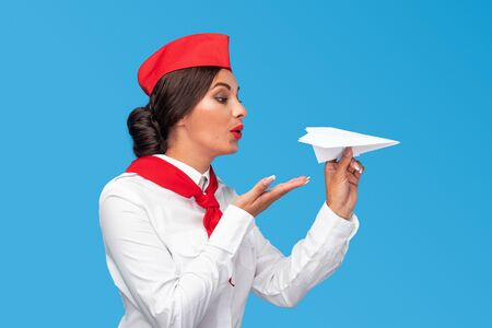 Middle East stewardess throwing paper airplane