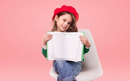 Creative girl showing blank book