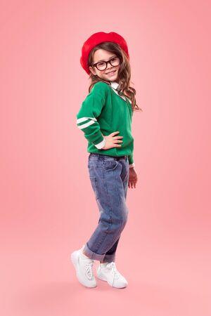 Positive stylish girl with hand on waist Foto de archivo