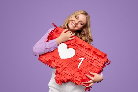 Happy female hugging red banner with social media like sign
