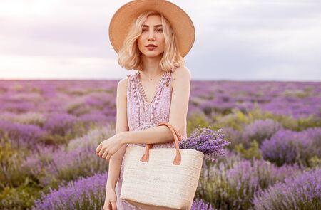 Stylish woman in lavender field