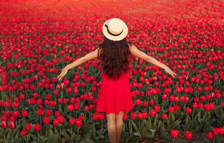 Carefree influencer in bright tulip field