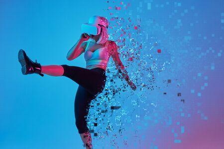 Virtual woman kicking air during game