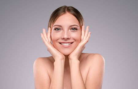 Happy young woman with clean skin looking at camera Banco de Imagens - 143073092
