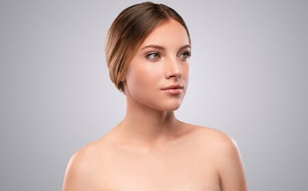 Charming bare shouldered woman with radiant skin