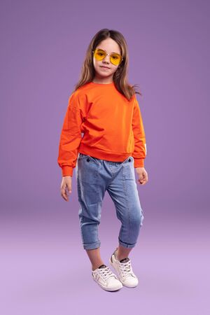 Trendy child in colorful outfit Banco de Imagens - 143073097