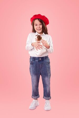 Happy girl with guinea pig Banco de Imagens