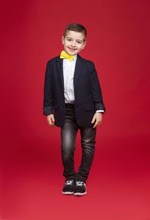 Stylish kid in suit smiling for camera Banco de Imagens