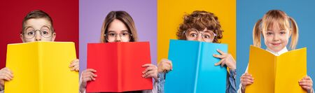 Cute schoolgirls and schoolboys hiding faces with books Banco de Imagens - 143073145
