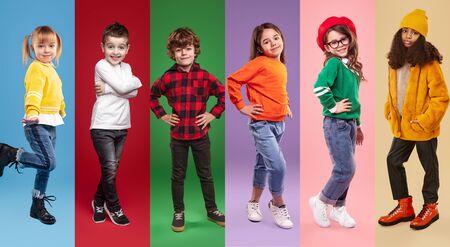 Set of diverse confident children in stylish casual clothes looking at camera while standing against vivid background in studio Banco de Imagens - 143047592