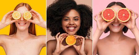 Optimistic multiracial women showing fresh citruses Banco de Imagens - 143073153