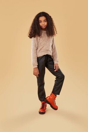 African American girl in trendy clothes Banco de Imagens