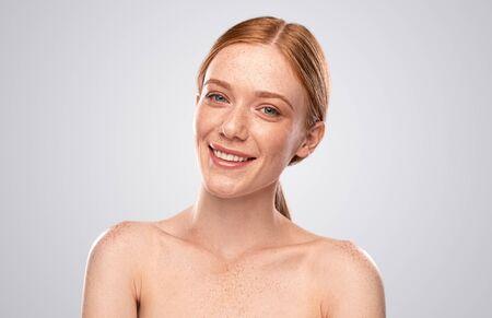 Cheerful ginger woman smiling for camera 版權商用圖片
