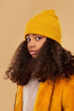 Trendy African American child looking at camera Standard-Bild - 147812218