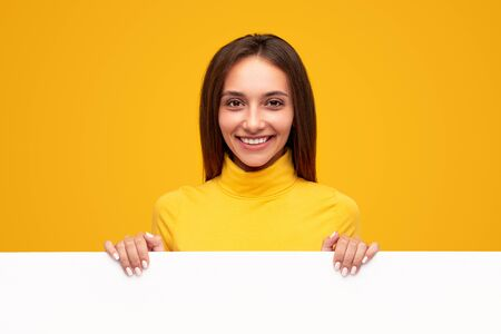 Friendly woman with blank poster