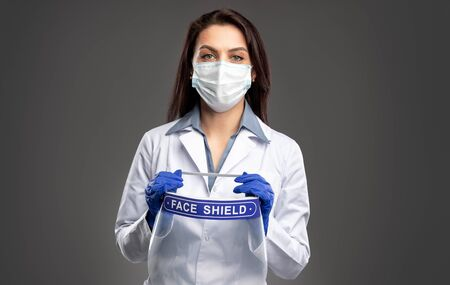 Medical practitioner with face shield