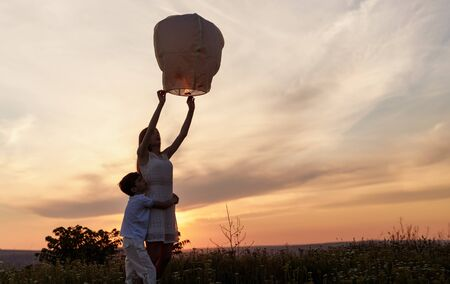 Brother and sister launching sky lantern