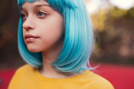 Teen girl with blue hair on playground