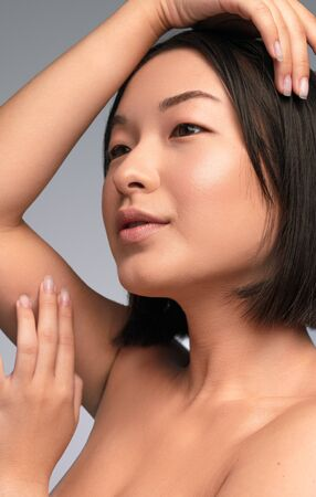 Asian woman enjoying skin softness