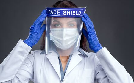 Female doctor in protective face shield