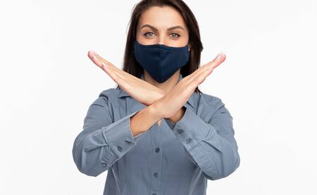 Woman in mask crossing arms Stock Photo