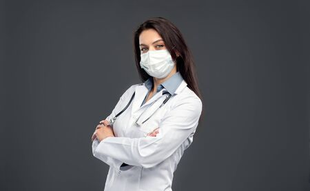 Confident doctor in mask looking at camera