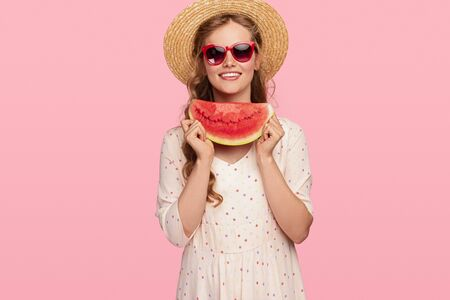 Happy young woman with fresh watermelon