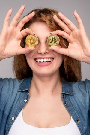 Rich woman with bitcoins having fun
