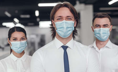 Business team in masks during epidemic