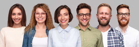Group of happy young people looking at camera