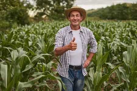 Mature farmer gesturing thumb up