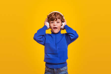 Shocked boy listening to music