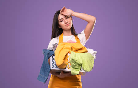 Tired woman with laundry basket
