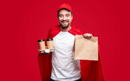 Cheerful male superhero delivering food Standard-Bild