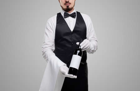 Anonymous waiter offering wine to camera