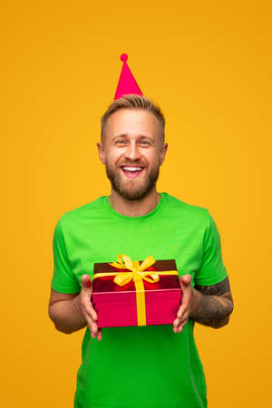 Excited bearded man with birthday gift