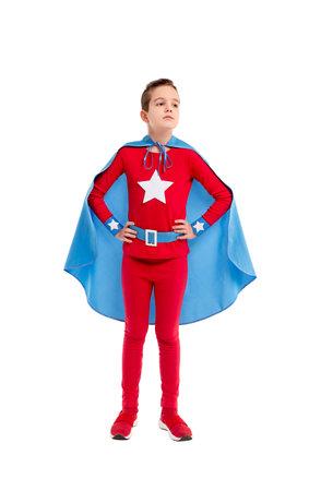 Confident little superhero looking away