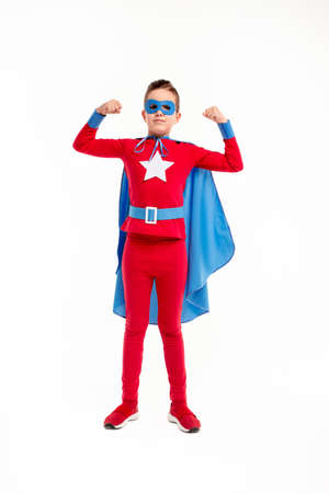 Strong little superhero showing muscles