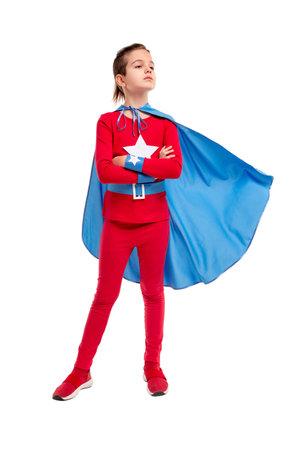 Confident little superhero with fluttering cape