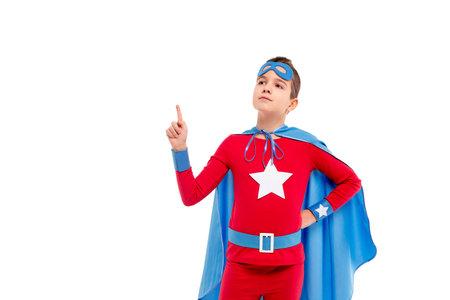 Confident little superhero pointing up