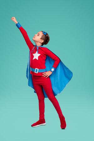 Strong little superhero preparing to fly Banco de Imagens