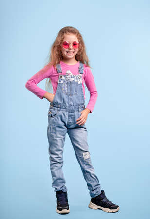 Fashionable girl in denim overall