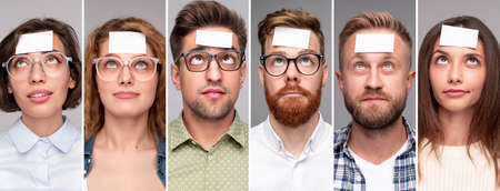 Puzzled people with sticky papers on foreheads