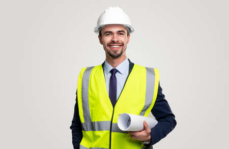 Smiling professional engineer with blueprints