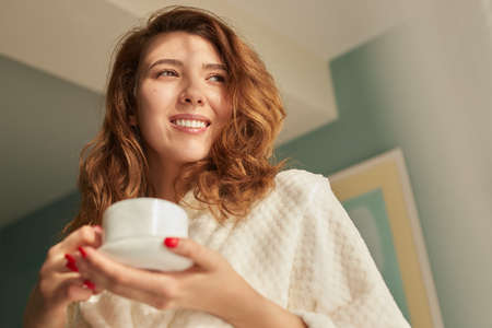 Happy woman enjoying morning coffee
