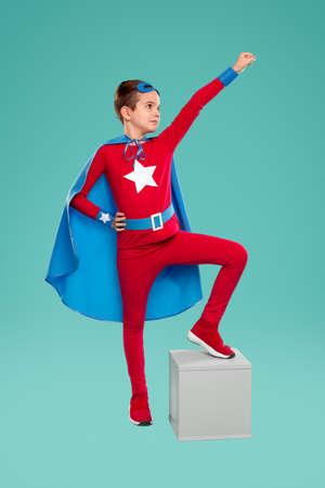 Brave superhero kid with arm raised