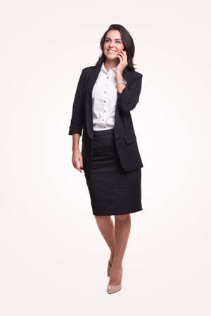 Smiling businesswoman speaking on phone 免版税图像