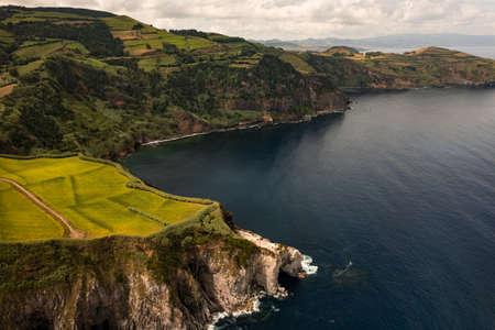 Picturesque coastline landscape with green hills