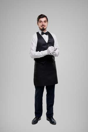 Elegant waiter with pen taking notes
