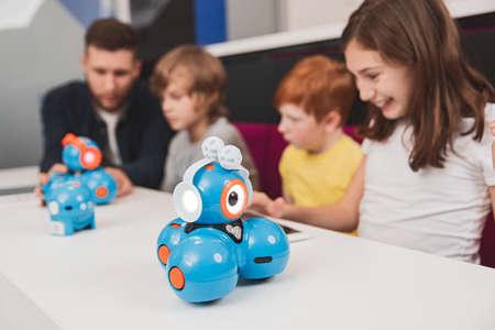 Schoolkids developing robots in classroom